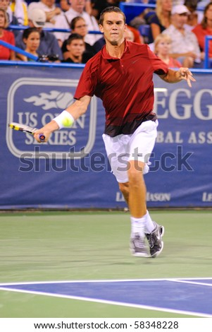 WASHINGTON - AUGUST 2: Ryan Sweeting (USA) plays in a first round match against James Blake (USA) at the Legg Mason Tennis Classic on August 2, 2010 in Washington.  Sweeting defeated Blake. - stock photo