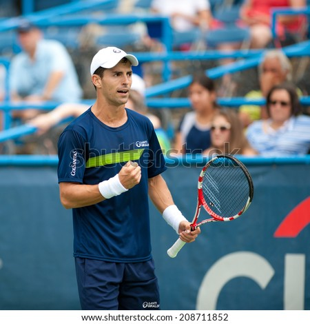 WASHINGTON AUGUST 2: Santiago Giraldo (COL) falls to Vasek Pospisil (CAN, not pictured) in semifinal play at the Citi Open tennis tournament on August 2, 2014 in Washington DC - stock photo