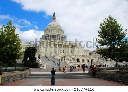 WASHINGTON - AUGUST 24, 2014: The United States Capitol which is located on the eastern side of the National Mall and is the seat of the US Congress.  - stock photo