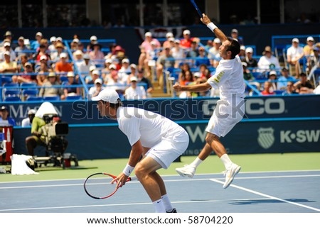 WASHINGTON - AUGUST 8: Tomas Berdych and Radek Stepanek (CZE) lose to Mardy Fish (USA) and Mark Knowles (BAH) in the doubles finals of the Legg Mason Tennis Classic on August 8, 2010 in Washington. - stock photo