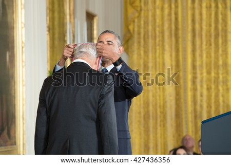 WASHINGTON, D.C. - MAY 19: President Obama awards Dr. Arthur Gossard on May 19, 2016 in Washington, D.C. The ceremony recognized the contributions of 17 top scientists, engineers, and inventors. - stock photo
