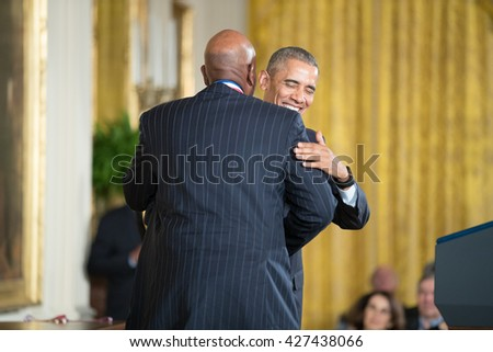 WASHINGTON, D.C. - MAY 19: President Obama awards  Dr. Cato T. Laurencin on May 19, 2016 in Washington, D.C. The ceremony recognized the contributions of 17 top scientists, engineers, and inventors. - stock photo