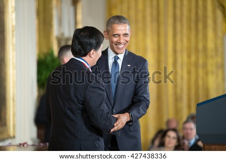WASHINGTON, D.C. - MAY 19: President Obama awards  Dr. Mark Humayun on May 19, 2016 in Washington, D.C. The ceremony recognized the contributions of 17 top scientists, engineers, and inventors. - stock photo