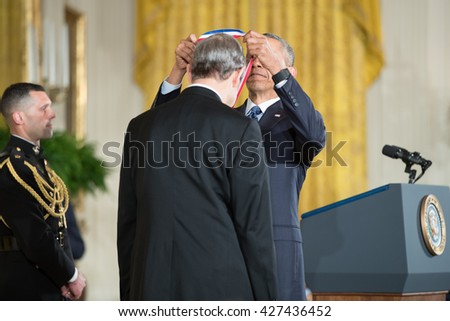 WASHINGTON, D.C. - MAY 19: President Obama awards Dr. Michael Artin on May 19, 2016 in Washington, D.C. The ceremony recognized the contributions of 17 top scientists, engineers, and inventors. - stock photo
