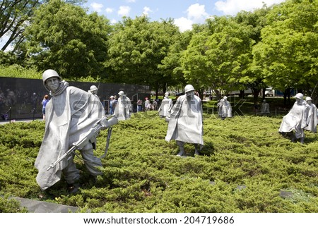 WASHINGTON D.C. - MAY 25 2014: Sculptures at Korean war veterans memorial in Washington DC. The memorial was dedicated July 27, 1995, the 42nd anniversary of the armistice ending the war. - stock photo