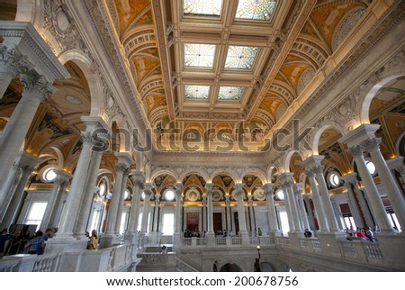 WASHINGTON D.C. - MAY 23 2014: Visitors in the  Library of Congress in Washington D.C. The Library of Congress is the nation's oldest federal cultural institution and the largest library in the world. - stock photo