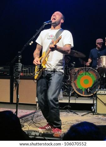WASHINGTON, D.C. - OCTOBER 4: Ben Harper performs at the 9:30 Club in Washington D.C. on October 4, 2011. - stock photo