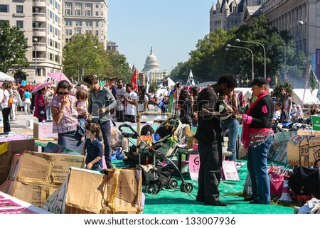 WASHINGTON D.C. - OCTOBER 8: Protesters march through the Nations capitol   during the 2011 Occupy movement on October 8, 2011 in Washington D.C. - stock photo
