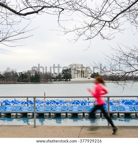 Washington DC - A runner in motion blur with Jefferson Memorial background - stock photo