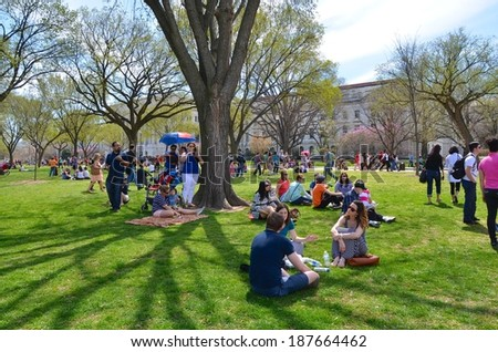 WASHINGTON, DC - APRIL 12: Cherry Blossom Festival on April 12, 2014 in Washington DC,USA. The festival is a spring celebration in Washington, D.C.and people from all over the world come to visit. - stock photo