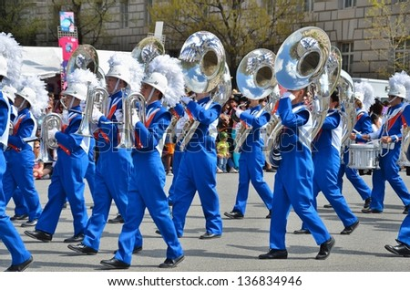WASHINGTON, DC - APRIL 13: Cherry Blossom Parade on April 13, 2013 in Washington DC,USA.The parade is a spring celebration in Washington D.C.and people from all over the world come to watch the event. - stock photo