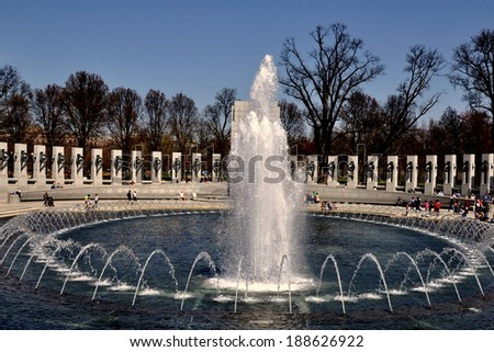 Washington, DC -April 10, 2014:  Fountains splashing in the central pool of the solemn World War Two Memorial on the National Mall - stock photo