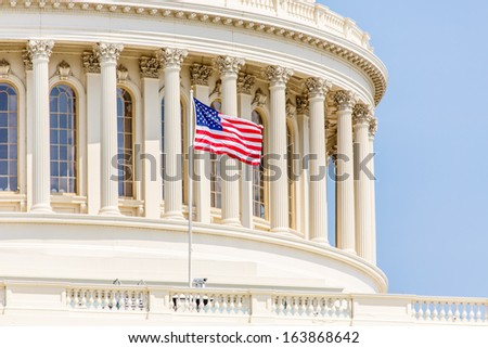 WASHINGTON, DC - AUGUST 13: Dome of US Capitol with US flag at full mast on August 13, 2013 in Washington, DC. The dome of US Capitol is one of the most famous landmarks in the nation's capital - stock photo