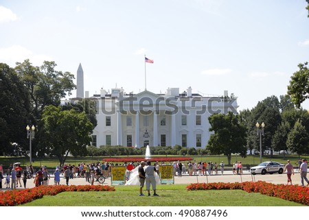WASHINGTON DC - AUGUST 19: Tourists visiting the US White House which is the main work place of the United States President currently Barack Obama August 19, 2016 in Washington DC, USA