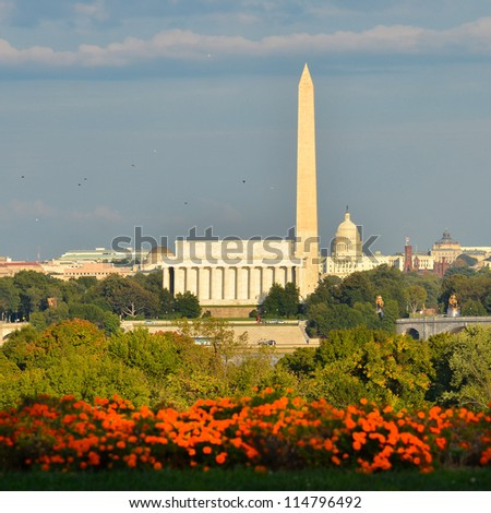 Washington DC city view in a cloudy autumn day, including Lincoln Memorial, Monument and Capitol building - stock photo