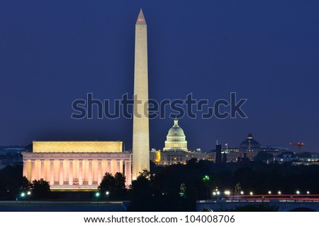 Washington DC city view in sunrise, including Lincoln Memorial, Monument and Capitol building - stock photo