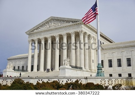 WASHINGTON, DC -19 FEBRUARY 2015- Flag flying at half-mast on the Supreme Court building to pay respect to the late Justice Antonin Scalia.