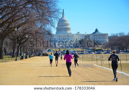 WASHINGTON, DC - FEBRUARY 22: Washington DC Capitol on FEBRUARY 22, 2014 in Washington DC,USA. The Capitol is a famous attraction in Washington DC, and people from all over the world come to visit. - stock photo