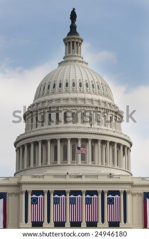 WASHINGTON, DC - JAN. 20: The dome of the United States Capitol Building decorated with historic flags for the 2009 inauguration of President Barack Obama. - stock photo