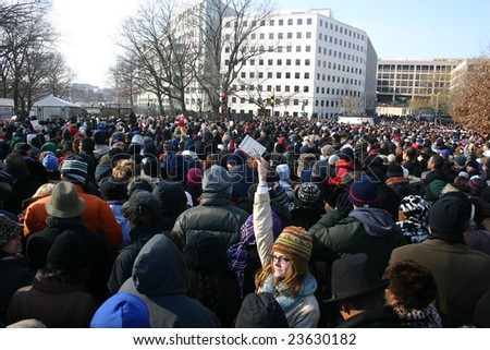 WASHINGTON, DC - JANUARY 20, 2009: Woman holds her ticket up in a crowd waiting at a security gate to enter the standing area near the Capitol on January 20, 2009. Many were turned away.