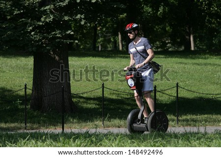 WASHINGTON, DC - JULY 29: A tourist operates a Segway during a Segway tour along the National Mall on July 29, 2013 in Washington.  - stock photo