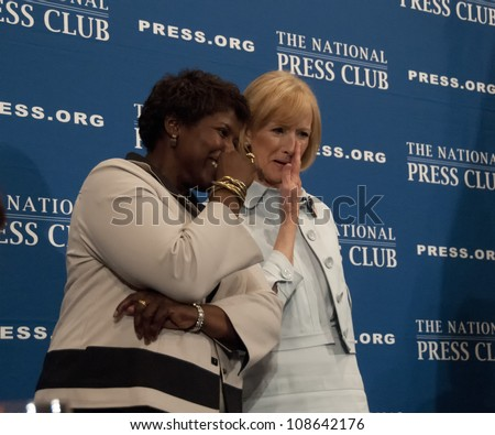 WASHINGTON, DC - JULY 24:  PBS newscasters and anchors Gwen Ifill and Judy Woodruff share a private comment after their speeches at the National Press Club, July 24, 2012 in Washington, DC - stock photo