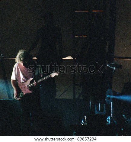 WASHINGTON DC - JULY 10: The band Pink Floyd plays in concert at RFK Stadium in Washington, D.C. on Sunday, July 10, 1994. The band members included  David Gilmour,  Nick Mason,  Roger Waters, and Richard Wright. VERY GRAINY - stock photo