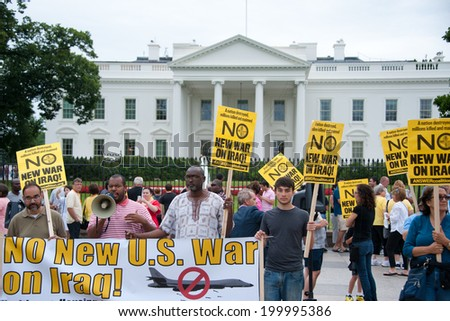 WASHINGTON, DC - JUNE 21: Anti-war demonstrators protest in front of the White House in Washington, DC on June 21, 2014. - stock photo
