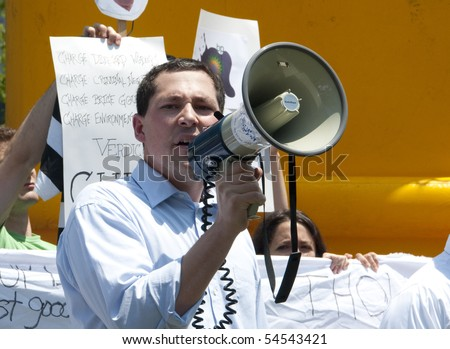 WASHINGTON, DC - June 4: Demonstration leader uses bullhorn to protest BP oil spill, demand criminal charges against company, June 4, 2010 in Washington, DC - stock photo