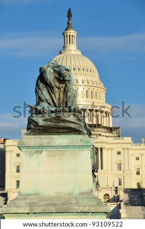 Washington DC - Lion statue in front of United States Capitol building - stock photo