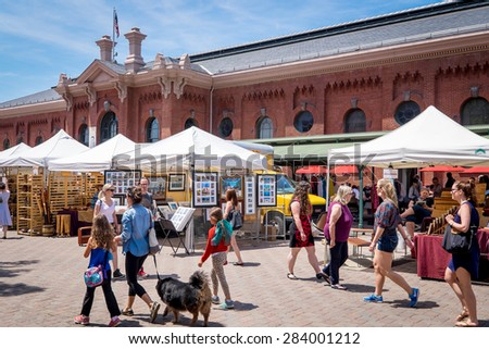 WASHINGTON DC-May 24, 2015: Historic Eastern Market in the Capitol Hill neighborhood, built in 1805. The indoor food market and outdoor artisan stalls attract both visitors and residents. - stock photo