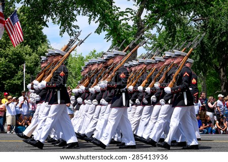 WASHINGTON DC-May 25, 2015: Memorial Day Parade. A marching platoon from the United States Marine Corps wearing blue-white dress uniforms. Close up profile view. - stock photo