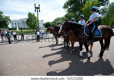 WASHINGTON, DC - MAY 1: Police on horseback watch as immigration reform activists protest on May 1, 2010 at the White House in Washington, DC.