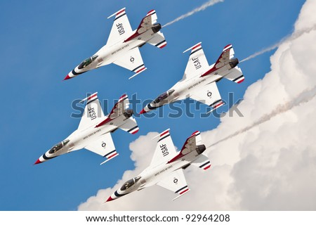 WASHINGTON DC - MAY 23:USAF Thunderbirds F-16 showing precision of formation flying during the airshow on May 23, 2011 Squadron was formatted on May 25, 1953 currently there are based at Nellis AFB - stock photo