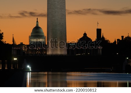 Washington DC, Monuments in silhouette at sunrise - stock photo