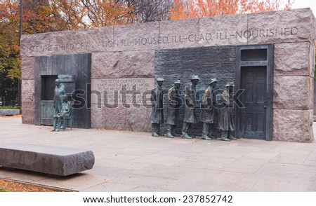 WASHINGTON, DC - NOVEMBER 16, 2014:  The Depression Breadline sculpture and Appalachian couple on the National Mall in autumn are major tourist attractions.