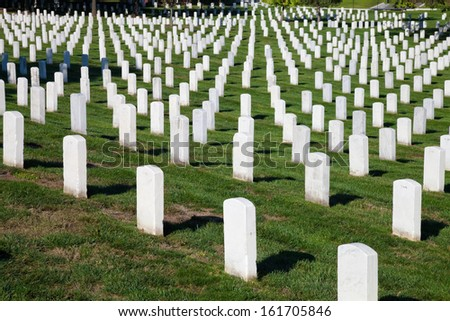 WASHINGTON DC - OCT 16: Rows and columns of US soldier's tombstones at Arlington National Cemetery in Washington DC on Oct. 16, 2012.