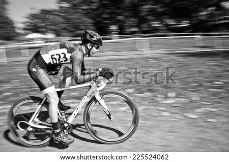 WASHINGTON DC - OCTOBER 18: Cyclists compete in the DC cyclocross competition on October 18, 2014 in Washington, DC  - stock photo