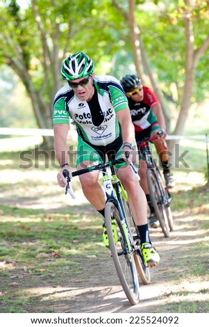 WASHINGTON DC - OCTOBER 18: Cyclists compete in the DC cyclocross competition on October 18, 2014 in Washington, DC