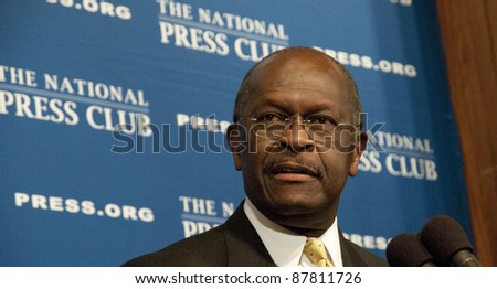 WASHINGTON, DC - OCTOBER 31: Republican Presidential contender Herman Cain speaks to a luncheon at the National Press Club, October 31, 2011 in Washington, DC - stock photo