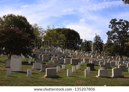 WASHINGTON DC - SEP 15: Rows and columns of US soldier's tombstones at Arlington National Cemetary in Washington DC on Sept. 15, 2012. - stock photo