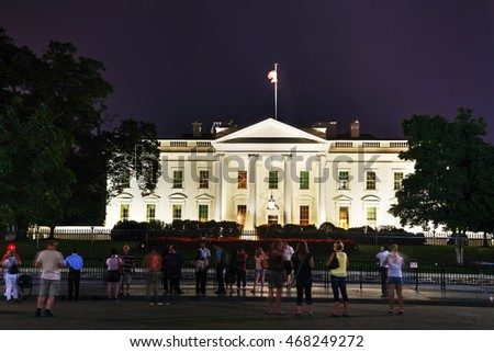 WASHINGTON, DC - SEPTEMBER 2: The White House building with tourists on September 2, 2015 in Washington, DC. It's the official residence and principal workplace of the President of the United States