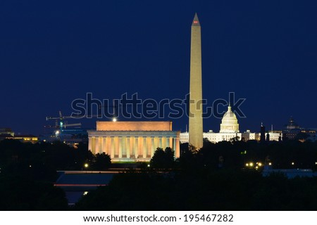 Washington DC skyline at night including Lincoln Memorial, Washington Monument and United States Capitol building  - stock photo