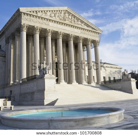 Washington DC, Supreme Court building with a blue sky background.