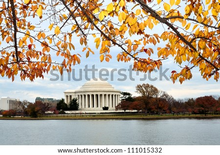 Washington DC, Thomas Jefferson Memorial in autumn with yellow tree branches foreground - stock photo