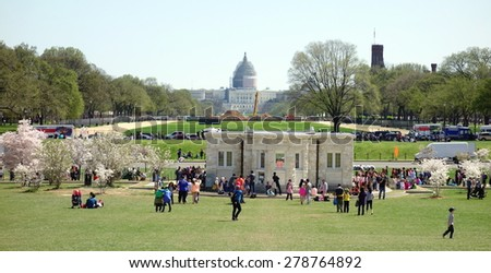 WASHINGTON DC, U.S.A. - APRIL 12, 2015: A view of The Mall and Capitol Hill in the background in Washington DC. - stock photo