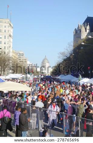 WASHINGTON DC, U.S.A. - APRIL 11, 2015: Crowd at the annual Cherry Blossom Parade in Washington DC. - stock photo