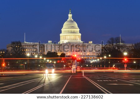 Washington DC, United States Capitol building night view from from Pennsylvania Avenue with car lights trails