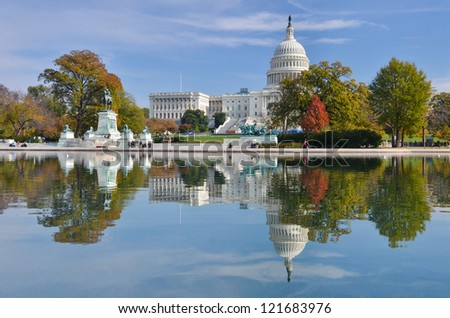 Washington DC, US Capitol Building and mirror reflection in autumn - stock photo