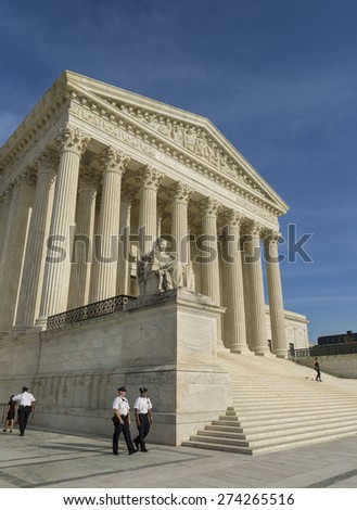 WASHINGTON, DC, USA - APRIL 06, 2015: United States Supreme Court building exterior, and Capitol Police officers.